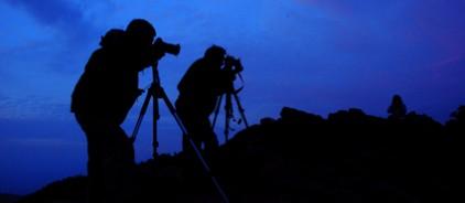 People taking photos at dark