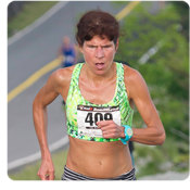 Annette Bednosky, the first woman to cross the finish line, did so in a new course record of 25:56. Photo by Skip Sickler.