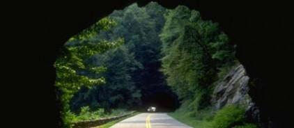 Car traveling through tunnel